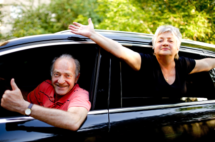 two older individuals in a car